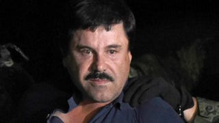 """Notorious drug kingpin Joaquin """"El Chapo"""" Guzmán is escorted into a helicopter at Mexico City's airport on Jan. 8, 2016, following his recapture during an intense military operation in Los Mochis, in Sinaloa state.ALFREDO ESTRELLA/AFP/Getty Images"""