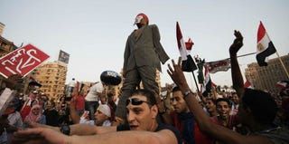 Egyptian protesters beat a dummy of Mohamed Morsi in Cairo's Tahrir Square. (Gianluigi Guercia/AFP/Getty Images)