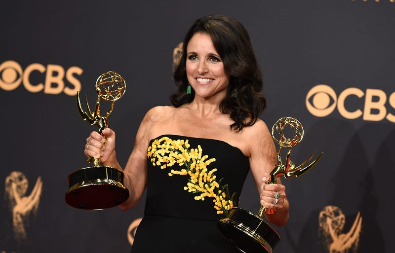 No stranger to accolades, here Julia Louis-Dreyfus double fists her Emmys.