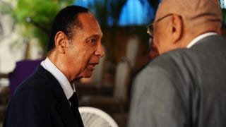 Former Haitian President Jean-Claude 'Baby Doc' Duvalier attends the funeral of former Haitian President Leslie Manigat in Port-au-Prince on July 5, 2014. HECTOR RETAMAL/AFP/Getty Images