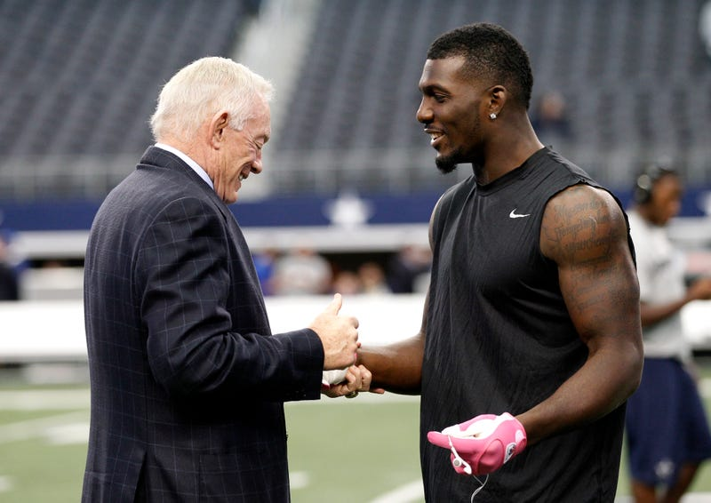 Dallas Cowboys team owner Jerry Jones, left, talks with wide receiver Dez Bryant, right, on the field before a NFL football game against the New York Giants Sunday, Oct. 28, 2012, in Arlington, Texas.