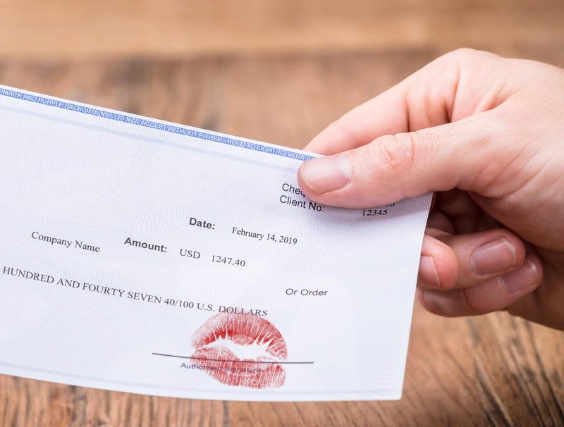 Illustration for article titled Boss Makes Lipstick Prints On Paychecks For Valentine's Day