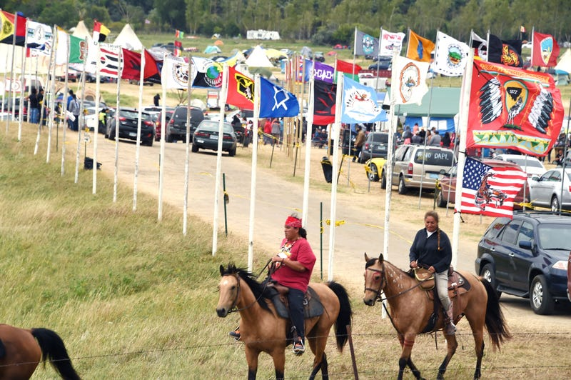 Flags of Native American tribes from across the U.S. and Canada line the entrance to a protest encampment near Cannon Ball, N.D., where members of the Standing Rock Sioux tribe and their supporters have gathered to voice their opposition to the Dakota Access Pipeline on Sept. 3, 2016.ROBYN BECK/AFP/Getty Images