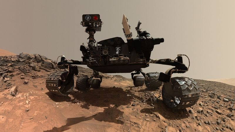 According to NASA, the Morbid Curiosity Rover used its scooping mechanism to hollow out what appeared to be a shallow grave in the martian soil and then seemed to contemplate it with its navigation cameras for days.