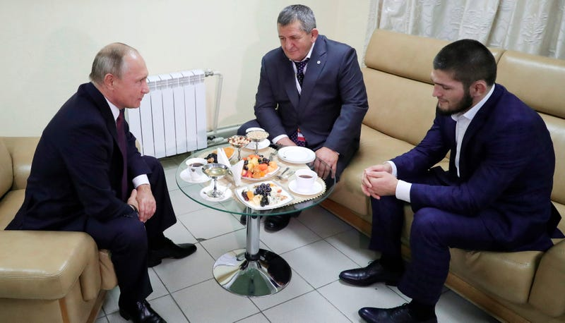 Illustration for article titled Vladimir Putin To Khabib Nurmagomedov's Father: Please Be Nice To Khabib