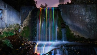 Illustration for article titled Putting Glowsticks Inside Waterfalls Is Mesmerizingly Beautiful