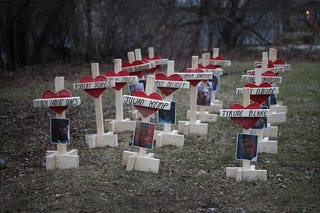 Forty-three crosses sit in a vacant lot in the Englewood neighborhood of Chicago on Jan. 23, 2017. Each cross, created by Greg Zanis, represents a victim of murder in Chicago in 2017. (Scott Olson/Getty Images)
