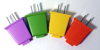 Illustration for article titled Straightforward Bi-Plug USB Charger Available in Four Bright and Gay Colors