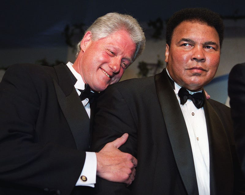 President Bill Clinton leans on former world boxing heavyweight champion Muhammad Ali on Oct. 28, 2000.   MANNY CENETA/AFP/Getty Images