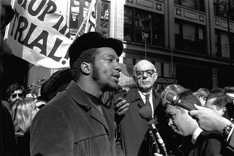 At a rally outside the U.S. Courthouse in Chicago on Oct. 29, 1969, Dr. Benjamin Spock, background, listens to Fred Hampton, chairman of the Illinois Black Panther Party. It was part of a protest against the trial of eight persons accused of conspiracy to cause a riot during the Democratic National Convention in 1968. (AP Images)