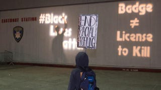 Protesters interact with messages projected on the wall of a police station Jan. 17, 2015, after an anti-police-brutality march in Oakland, Calif.Josh Edelson/Getty Images