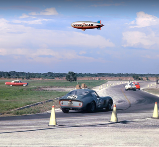Illustration for article titled The Greatest Motorsport Picture Ever Has A Ferrari 250 GTO And A Blimp