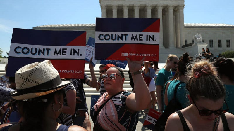 People gather in front of the U.S. Supreme Court as decisions are handed down June 27, 2019. The high court blocked a citizenship question from being added to the 2020 census.