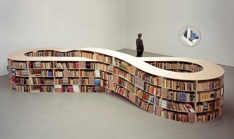 Illustration for article titled Infinity Bookcase Stores Finite Amount of Books, Is Infinitely Cool Anyway
