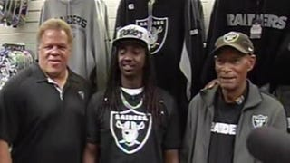 Akintunde Ahmad (center) with Oakland Raiders General Manager Reggie McKenzie (left) and Hall of Famer Willie Brown.ABC 7 News Screenshot