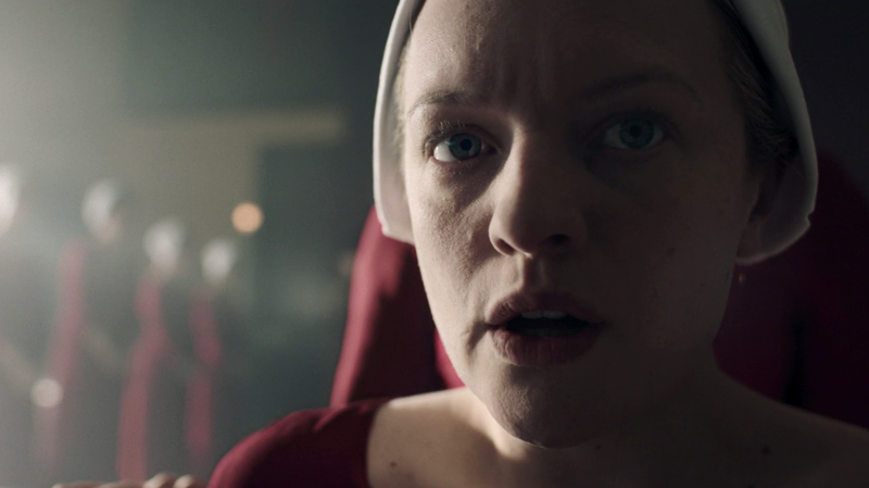 June (Elisabeth Moss) is instructed in how to give birth, even though she's already done it.