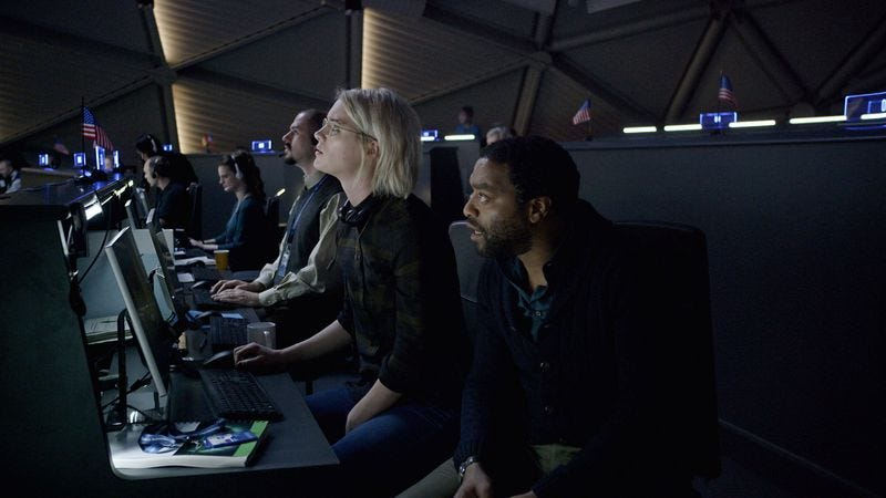 Mackenzie Davis as Mindy Park, and Chiwetel Ejiofor, playing Dr. Vincent (originally Venkat) Kapoor, in The Martian