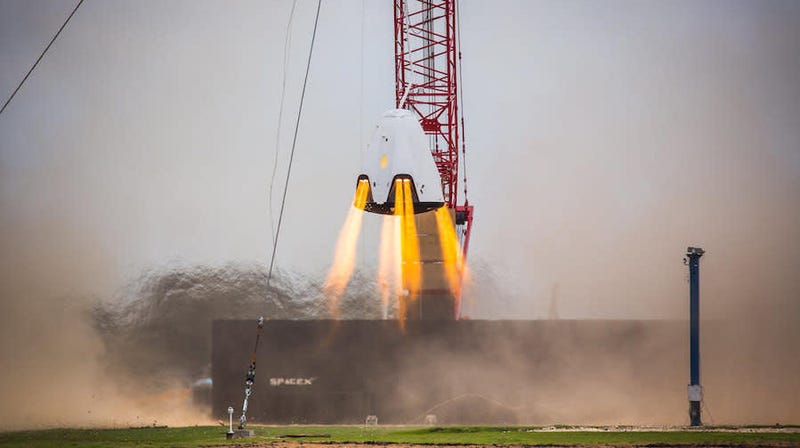 A SpaceX Crew Dragon capsule undergoing a hover test in 2015.