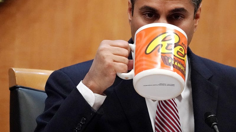 FCC chairman Ajit Pai drinks from a comically large mug before ignoring the will of the American public and voting to deregulate the internet. (Photo: Alex Wong/Getty Images)