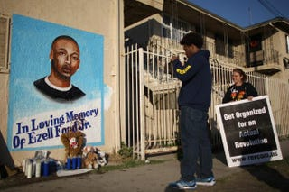 Activists look at a mural of Ezell Ford on Dec. 29, 2014, at the site where the 25-year-old mentally ill man was shot and killed by Los Angeles police in August.David McNew/Getty Images