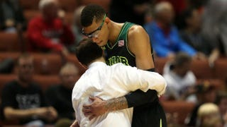 Isaiah Austin hugs head coach Scott Drew of the Baylor Bears as he is taken out of the game March 27, 2014, against the Wisconsin Badgers during the regional semifinal of the 2014 NCAA Men's Basketball Tournament at the Honda Center in Anaheim, Calif.Jeff Gross/Getty Images