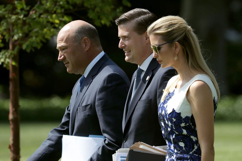 Then-National Economic Council Director Gary Cohn, then-White House staff secretary Rob Porter and Ivanka Trump walk across the South Lawn of the White House on Aug. 30, 2017.