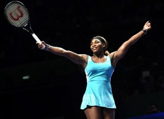 Serena Williams celebrates winning the WTA Finals for the third time in a row and fifth overall in Singapore on Oct. 26, 2014. World No. 1 Williams beat Romania's Simona Halep 6-3, 6-0.  ROSLAN RAHMAN/AFP/Getty Images
