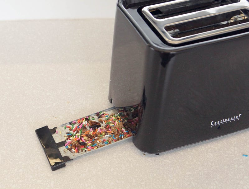 Toaster S Crumb Tray Full Of Sprinkles