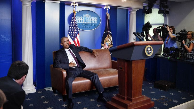 Illustration for article titled Bloated Obama Delivers Press Conference From Couch Behind Podium