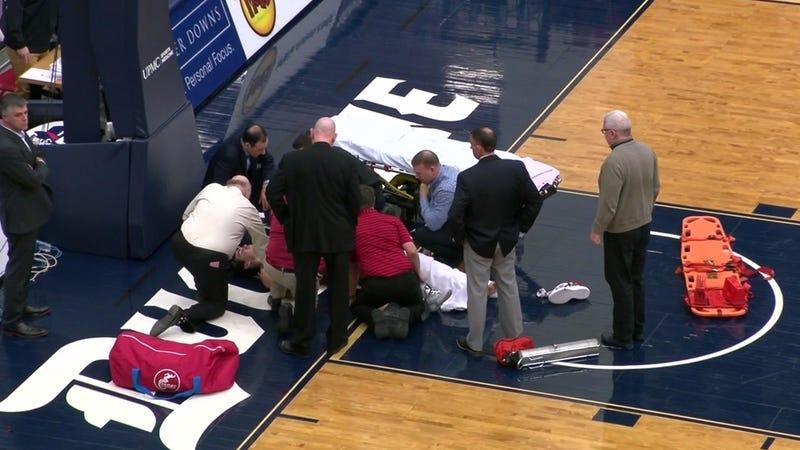 Illustration for article titled Saint Joseph's Player Taken Off In Stretcher After Brutal Leg Injury