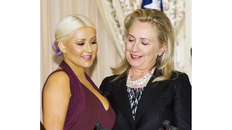 Illustration for article titled Not Even Hillary Clinton Can Look Away From Christina Aguilera's Ample Bosom