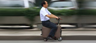 Illustration for article titled This Chinese farmer is recycling suitcases into electric scooters