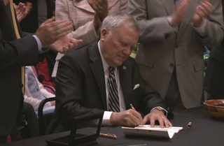 Georgia Gov. Nathan Deal signs a bill April 16, 2015, that allows patients suffering from illness to use cannabis oil as a treatment option.Alive 11 Screenshot