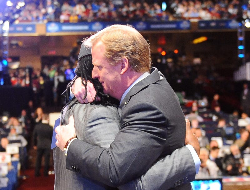 Illustration for article titled 'If You Cross Me I Will End You,' Goodell Whispers Into Ear Of Every Draft Pick