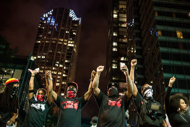 Demonstrators take a break from marching Sept. 22, 2016, in Charlotte, N.C.Sean Rayford/Getty Images