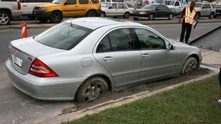Illustration for article titled Dallas Mercedes Driver Parks In Wet Concrete