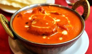 Illustration for article titled Love Butter Chicken? Visit these restaurants in Delhi