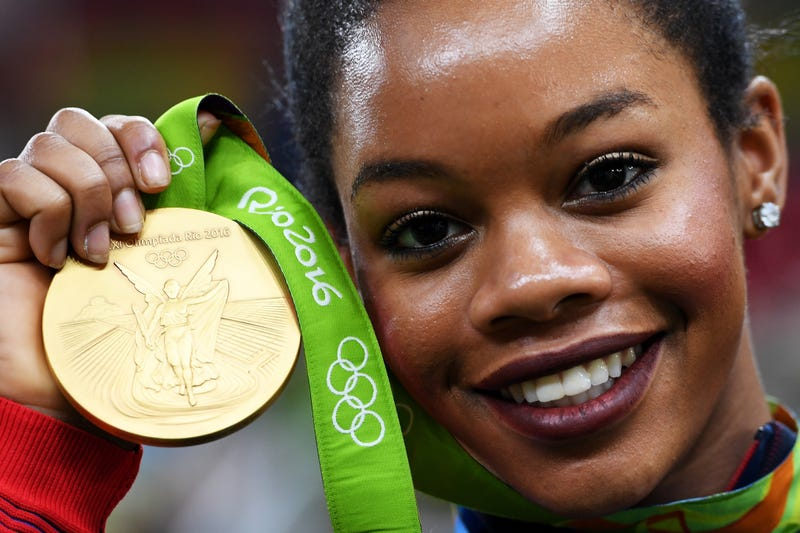 Gabby Douglas poses with her Olympic gold medal after the medal ceremony for the Artistic Gymnastics Women's Team at the Rio de Janeiro Olympics on Aug. 9, 2016.Laurence Griffiths/Getty Images