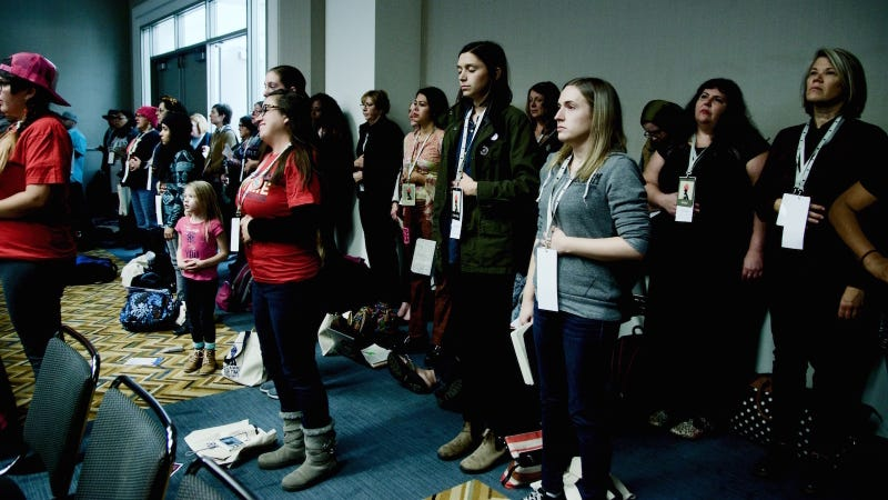 Women's Convention attendees monitor their breath at a public speaking breakout session. Photo by Ellie Shechet.