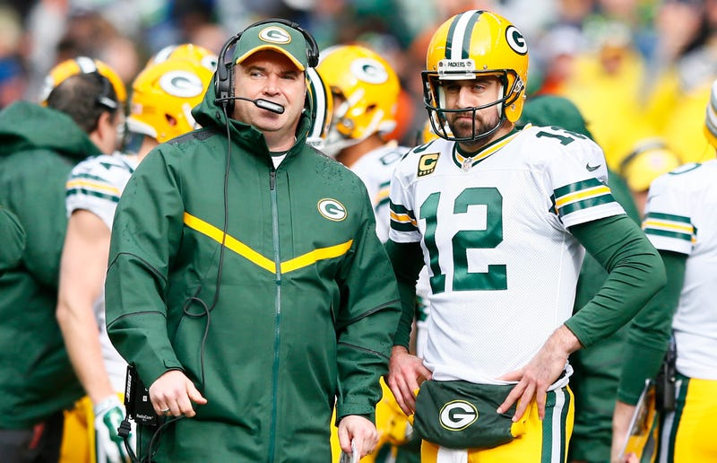 """Illustration for article titled Aaron Rodgers Insists He Got Along Fine With Ex-Packers Coach Mike McCarthy, Says They're Just Both """"Alpha Males"""""""
