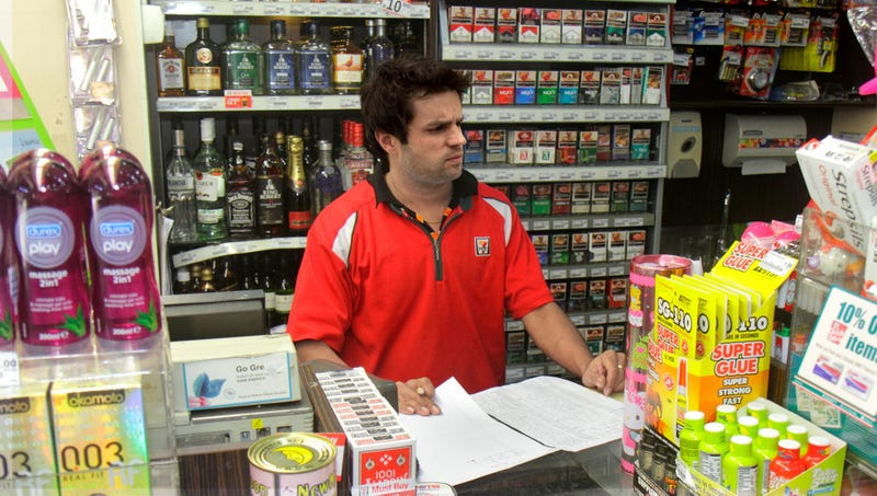 Illustration for article titled Customers Relieved To See Perky 7-Eleven Cashier's Spirit Has Finally Been Crushed