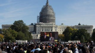 """Nation of Islam leader Louis Farrakhan is projected on a screen as he speaks during the """"Justice or Else"""" rally on the National Mall in Washington, D.C., Oct. 10, 2015, to commemorate the 20th anniversary of the Million Man March, which took place Oct. 16, 1995.Andrew Caballero-Reynolds/AFP/Getty Images"""