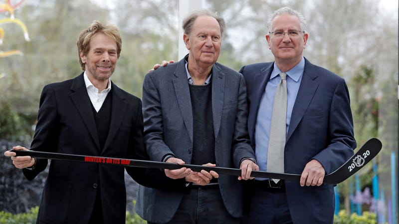 Seattle part-owners Jerry Bruckheimer, left, and David Bonderman, center, with president/CEO Tod Leiweke and a hockey stick.