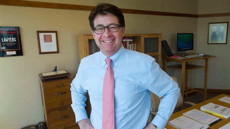 Strang, posing provocatively in his office in Madison, Wisconsin. (Photo: Getty Images)