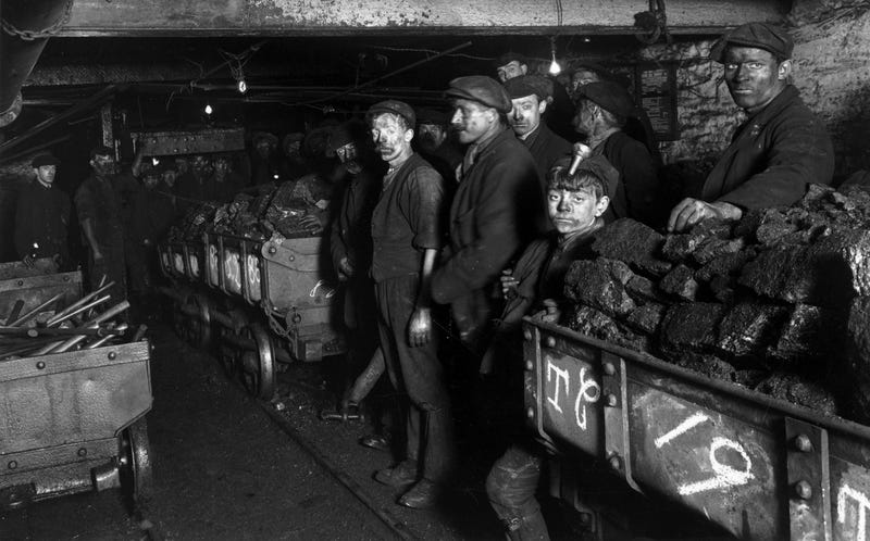 Coal miners in England in 1910 (Photo by Topical Press Agency/Getty Images)