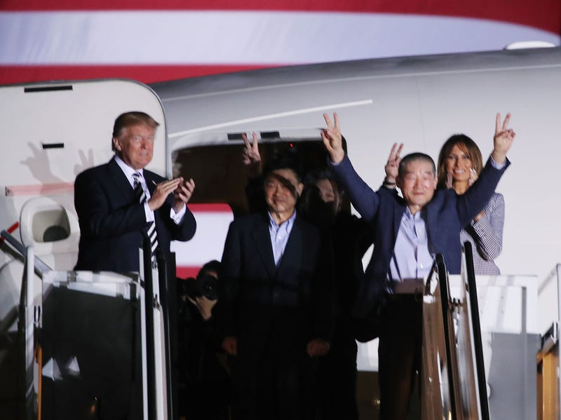 President Donald Trump applauds the three Americans just released from North Korea—Kim Dong Chul, Kim Hak-song and Tony Kim—at Joint Base Andrews on May 9, 2018, in Maryland.