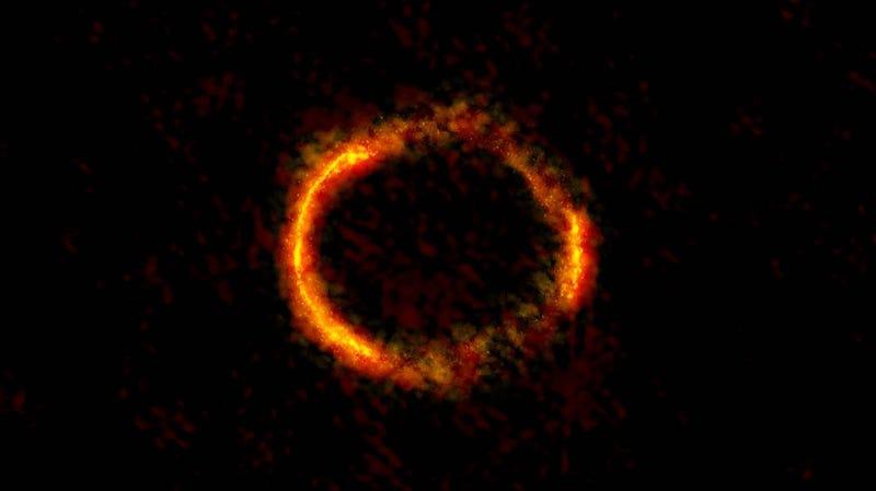 Illustration for article titled Descubren un anillo de Einstein casi perfecto al alinearse dos galaxias