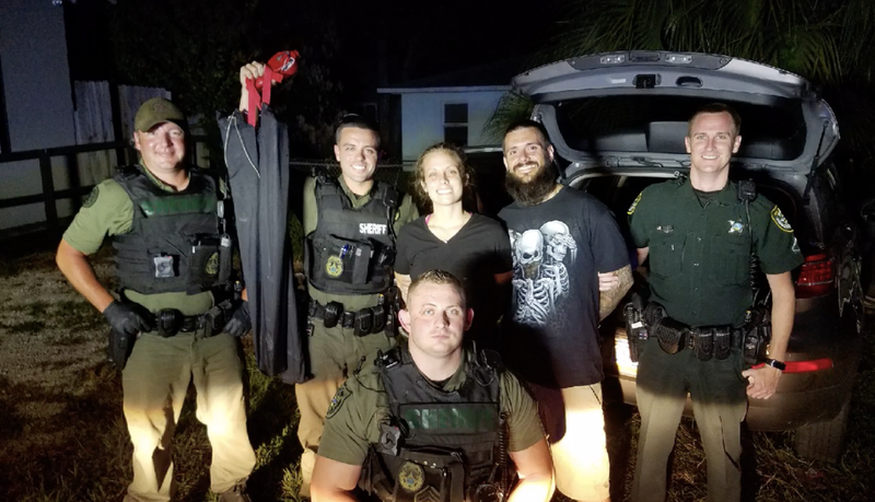 Volusia County deputies pose with the two suspects