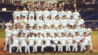 Illustration for article titled Your Marlins Team Photo, Complete With Both Of John Buck's Middle Fingers