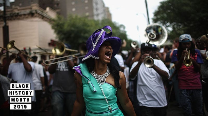 Club members and performers march during the Divine Ladies Social Aid and Pleasure Club 'second line' parade on May 17, 2015 in New Orleans, Louisiana. Traditional second line parades are put on by social aid and pleasure clubs organized by neighborhood in New Orleans.